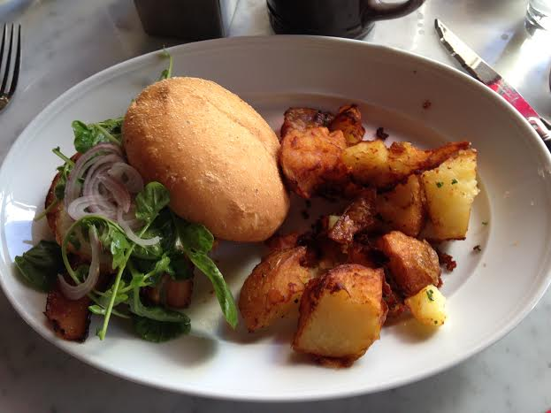 The breakfast Sandwich ($13) with fried potatoes ($6) and Stumptown coffee ($4)