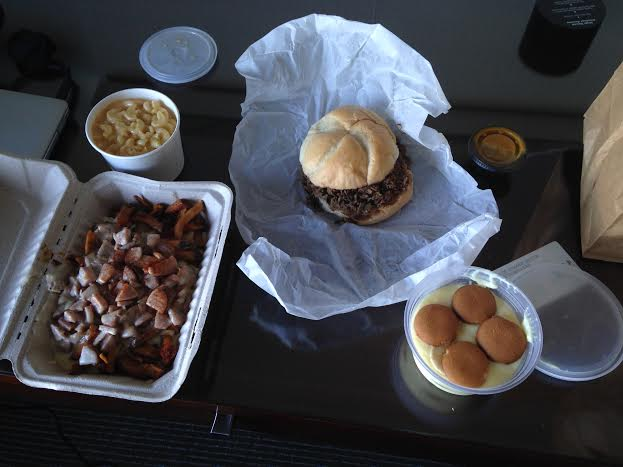 Mac and Cheese ($3.50), Brisket Sandwich $6.99), Banana Pudding ($4.25) and White Trah Fries ($6.25)